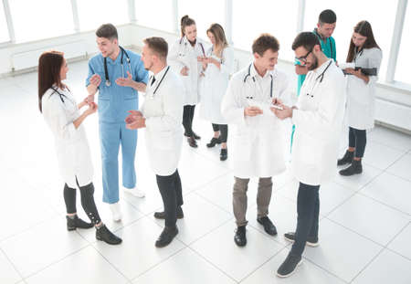 group of medical staff discussing business documents