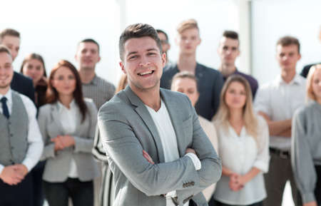 confident Manager standing at the front of the business team Stockfoto