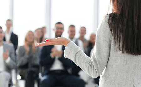 young businesswoman finishing her speech to the applause of the business team. business and education Stock Photo