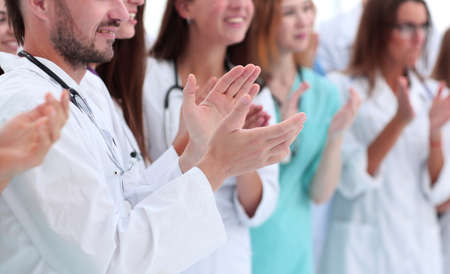 group of diverse doctors applauding their joint success
