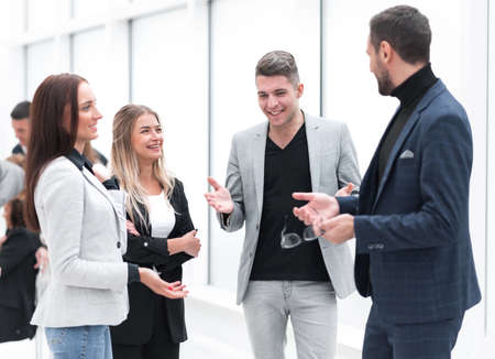 Manager telling about something to young employees. Stockfoto