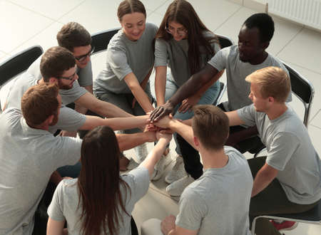 young business people making a tower out of their hands