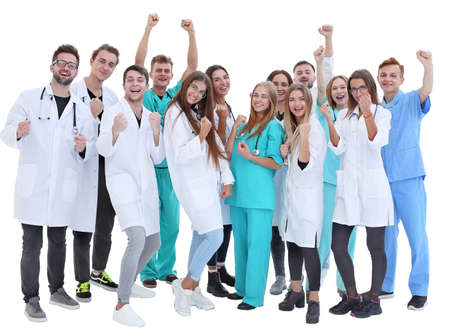 top view. a group of smiling doctors pointing at you. Archivio Fotografico