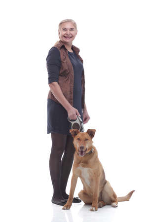 in full growth. female dog handler with a pet dog.