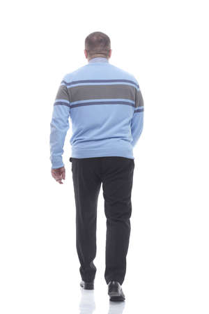 rear view. a modern man in a sweater goes forward 版權商用圖片