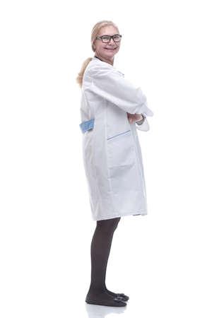 side view. friendly female doctor looking forward 版權商用圖片