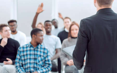 speaker and a group of diverse young listeners in a conference room Stock Photo