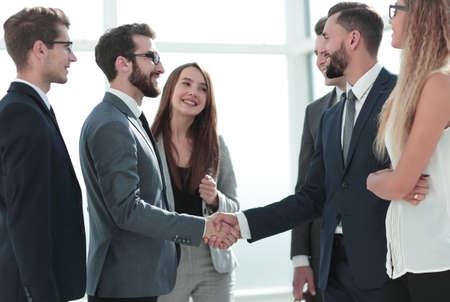 smiling business partners shaking hands Standard-Bild