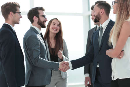 smiling business partners shaking hands Imagens