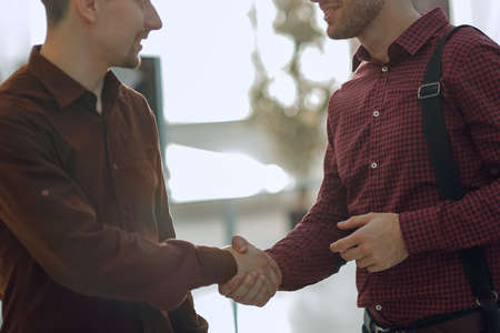 handshake colleagues in the office.