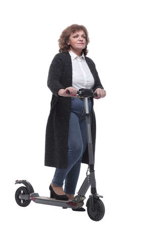 in full growth. confident adult woman with an electric scooter