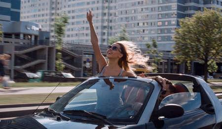 happy couple enjoying a trip in a luxury car.