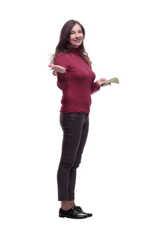 in full growth. casual young woman with a bundle of banknotes
