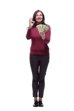 in full growth. happy young woman with banknotes