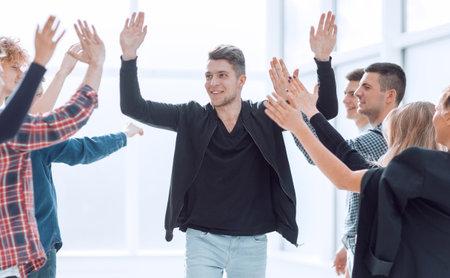 rear view. leader and business team applauding their success Standard-Bild