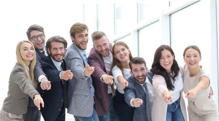 in full growth. a team of successful young people pointing at you. Archivio Fotografico
