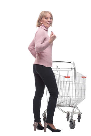 Rear view of casual woman with empty shopping cart on white background Stock fotó