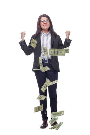 Happy brunette woman in glasses with lucky money - dollars coming down like rain