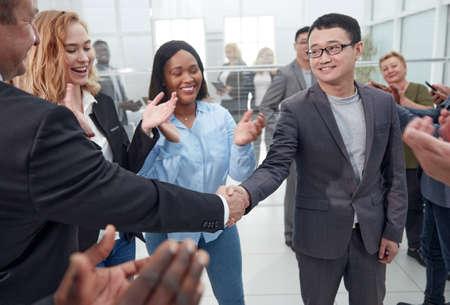 close up. international business partners shaking hands.