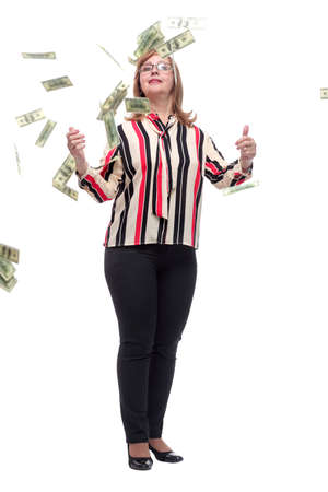 in full growth. happy woman standing in the rain of money.