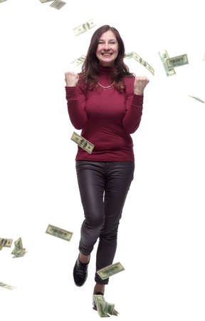 very happy young woman standing in the rain of money