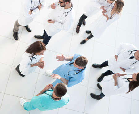 top view. team of medical professionals discussing issues together.