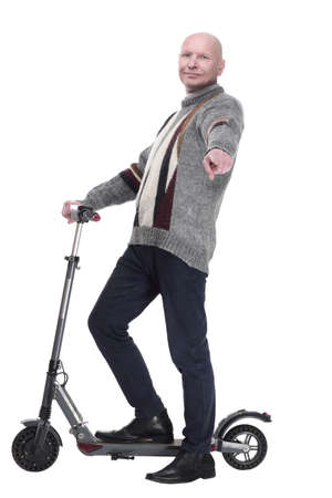 side view. mature man with electric scooter looking at you.