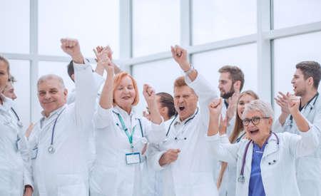 large group of diverse doctors celebrating together.