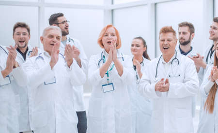 group of medical colleagues applauding their overall success.