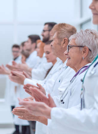 large group of medical practitioners applauding together. Imagens