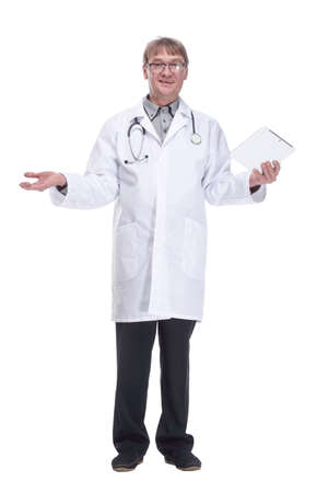 smiling doctor with a digital tablet .isolated on a white background.