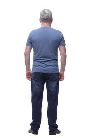 Back view of a man in t-shirt and jeans looking away
