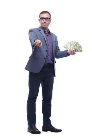 Happy attractive man in glasses holding bunch of money while pointing with finger on you