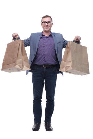 Good looking young man holding shoping bags