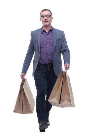 Picture of handsome smiling man in suit with shopping bags Standard-Bild