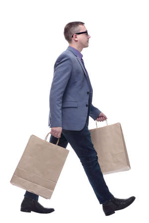 Young businessman wearing jeans and glasses with shopping bags