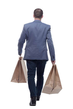 Back view of going handsome man with shopping bags Standard-Bild - 167072334