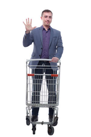 A full length portrait of a man pushing an empty shopping cart