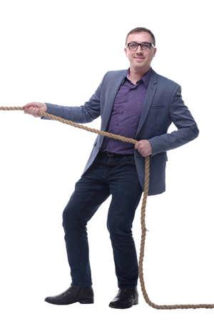 Handsome businessman in glasses pulling a rope Standard-Bild - 167073244
