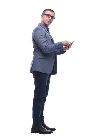 Portrait of surprised businessman looking at camera and holding cellphone Standard-Bild