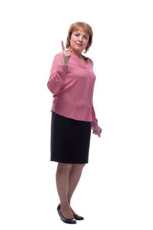 Portrait of a happy senior woman pointing upwards, isolated on a white background
