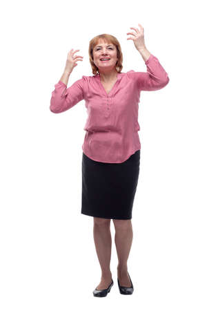 Smiling elderly woman keeping arms raised and looking up while standing isolated on white background