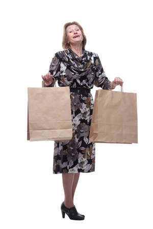 Full isolated portrait of a senior woman with shopping bags happy smiling