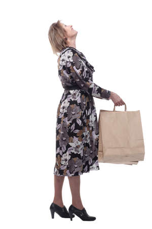 Portrait of happy senior woman posing with her shopping bag Standard-Bild - 167073308