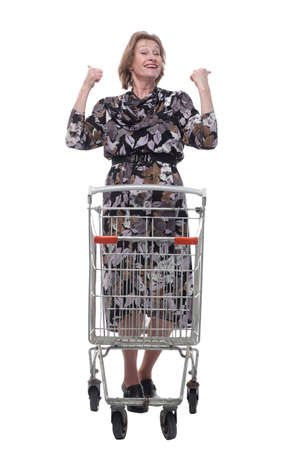Happy woman with a shopping cart with arms up