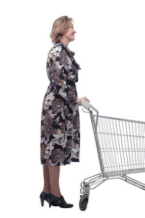 Profile of mature woman, pensioner shopping with shopping trolley