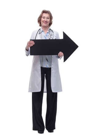 Friendly senior medical doctor pointing direction with arrow