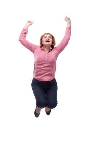 A mature woman jumping into the air with excitement