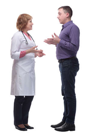Happy doctor talking to her male patient