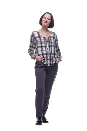 attractive mature woman in trousers and plaid shirt .